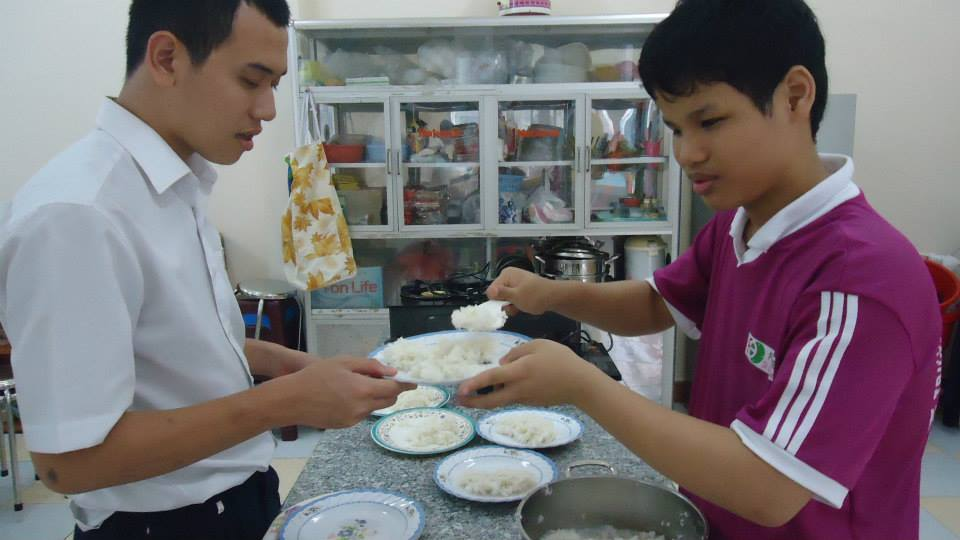 student serving rice