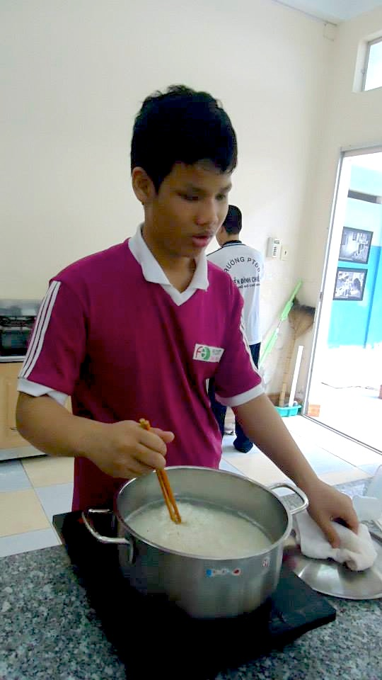 student cooking rice