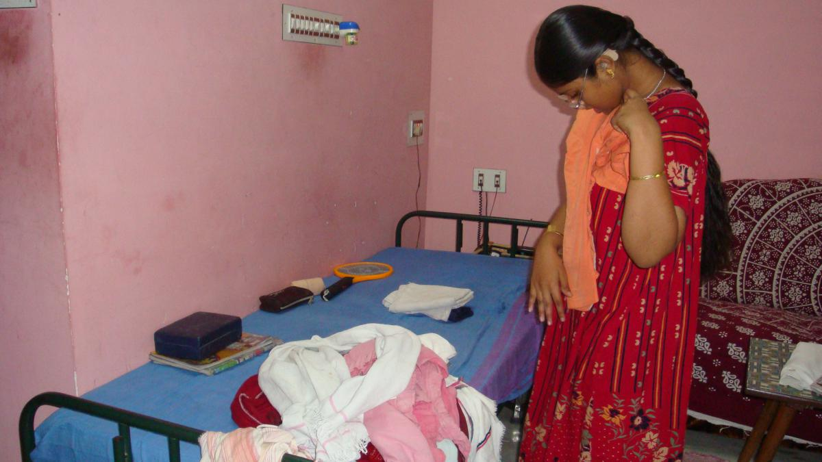 Photo of Sathiya folding her clothes.