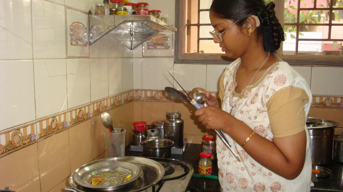 Sathiya helps with the cooking and washing up in the kitchen.