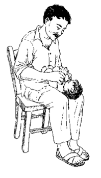 A man holds a baby on his lap