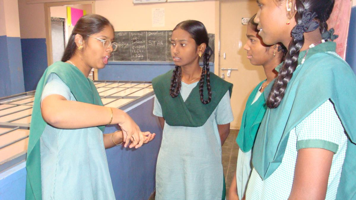 Sathiya chats with her classmates.