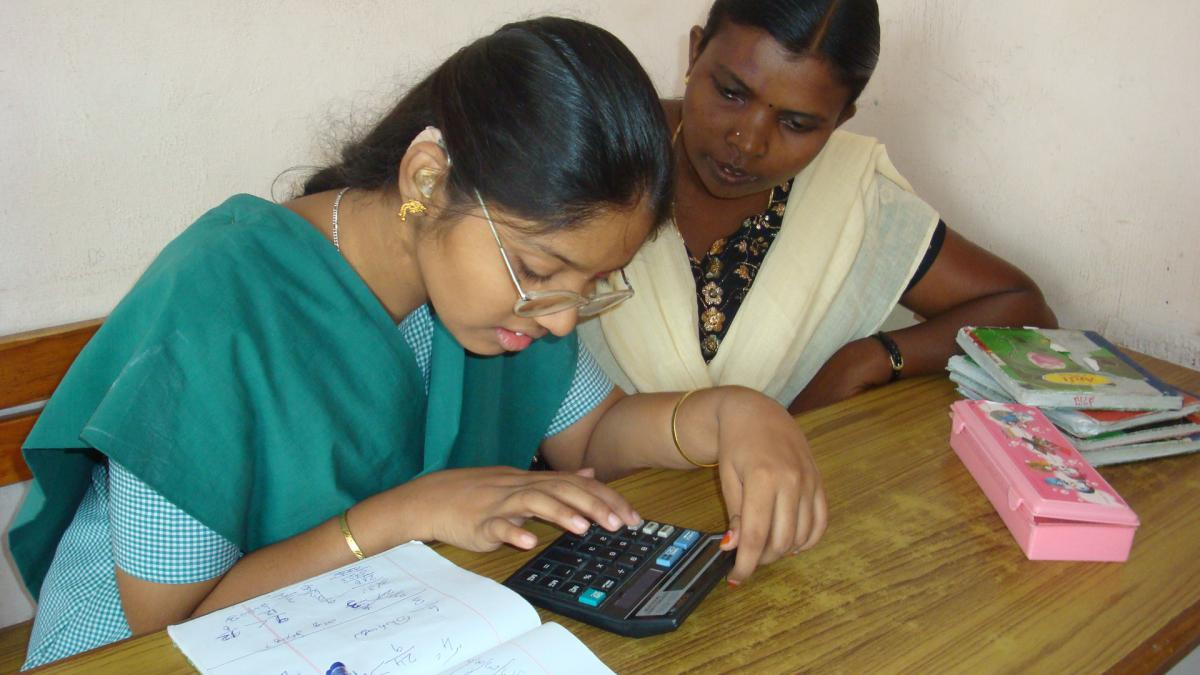 Sathiya learns to use a calculator.