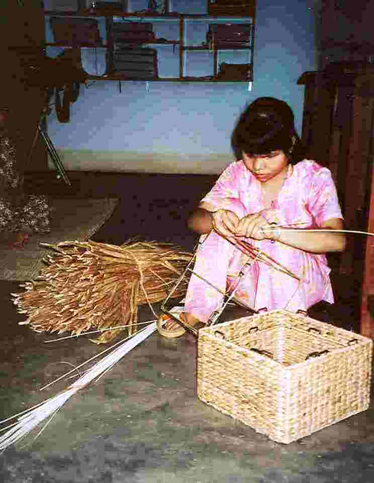 A girl weaves a basket