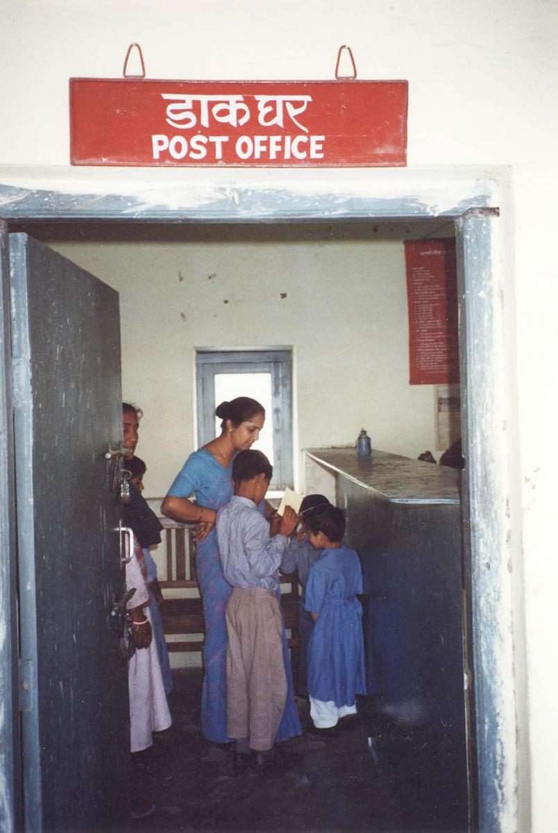 A group of students in India visits the post office.