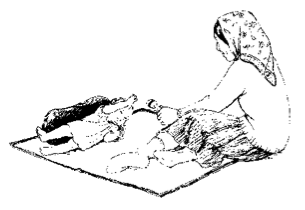woman sitting on mat with young child