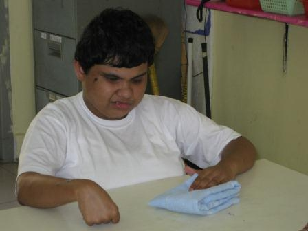 Student folds towel