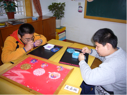 Two boys make handicrafts