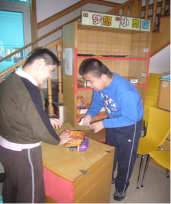 Photo of young man managing a small shop