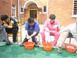 Photo of students doing laundry by hand
