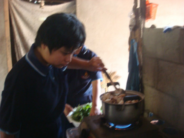 The youth participate in all stages of the process, from growing and harvesting the mushrooms, to washing and cooking them.