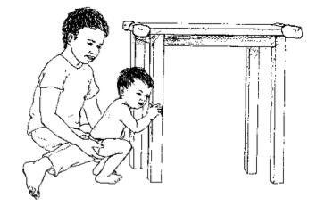 child holding on to table leg