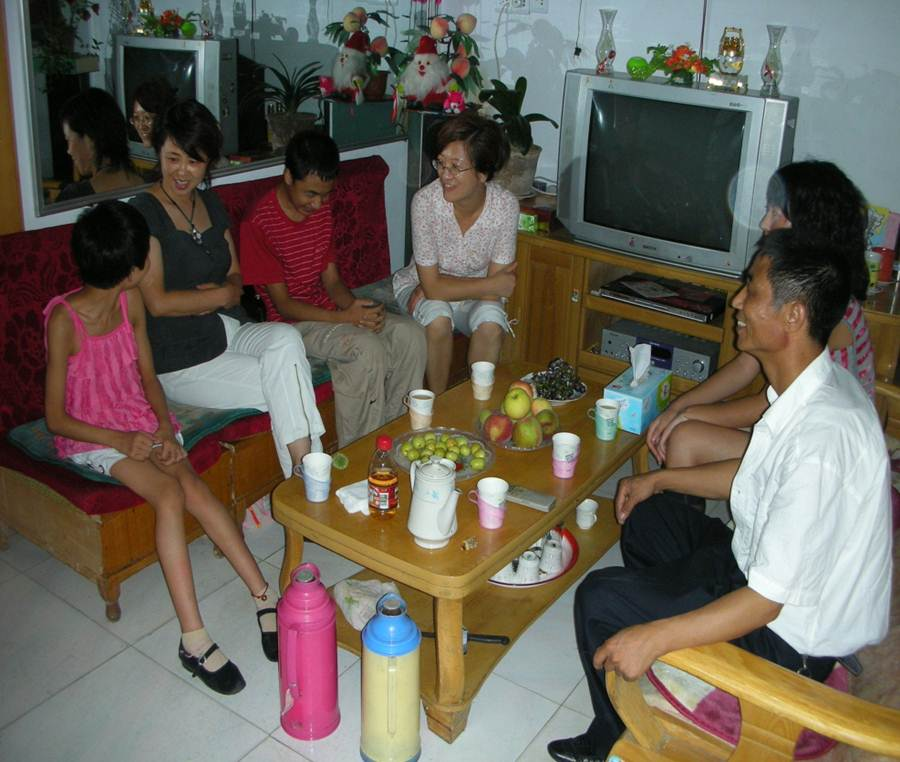 Photo of teachers visiting a student at home