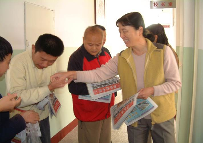 Students sell newspapers in the school
