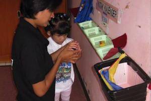 A young girl examines her calendar box