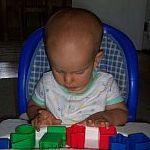 Young boy plays with blocks