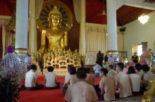 Students pray in a Buddhist temple.