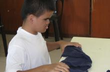 Boy folds clothes