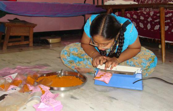 Photo of girl sitting on floor making curry powder