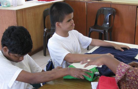 Photo of two boys folding clothes