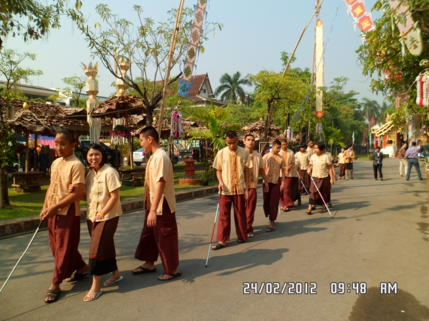 Students travel to the temple using canes and sighted guide