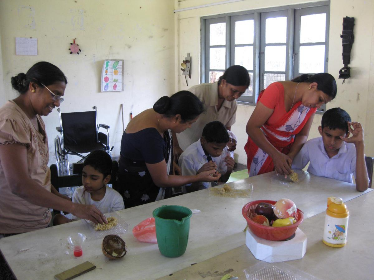 Students participate in a cooking class in Sri Lanka