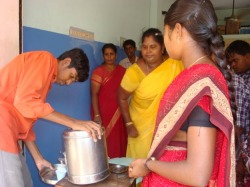 Photo of boy serving food to others.